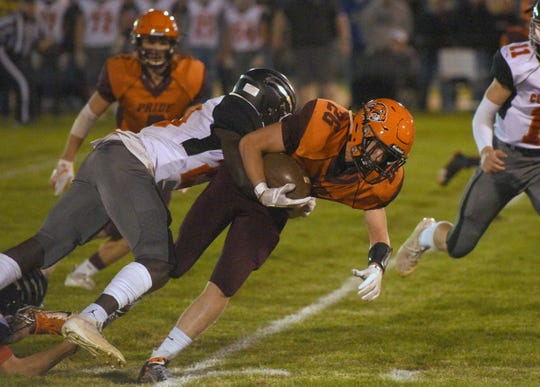 Canistota/Freeman's Blake Anderson is brought down by Viborg-Hurley's Angel Johnson on Friday, Oct. 18, in Canistota.