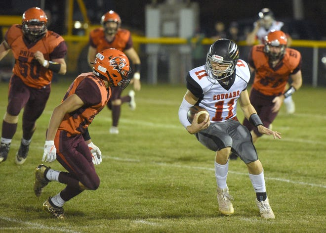 Viborg-Hurley's Chase Mason carries the ball while being pursued by Canistota/Freeman's Isiah Robertson on Friday, Oct. 18, in Canistota.