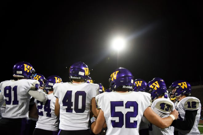 Watertown football players huddle during the game against Roosevelt on Friday, Oct. 18, 2019 at Howard Wood Field.
