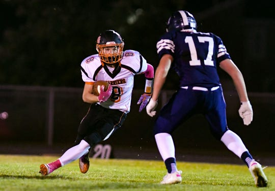 Logan Ellingson of Dell Rapids runs the ball around West Central's Logan Maras during their football game on Friday, October 18, in Hartford.