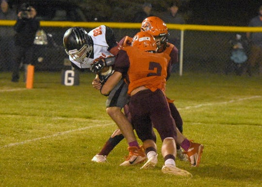 Viborg-Hurley's Justin Harms hauls in a pass and is brought down by two Canistota/Freeman players Friday, Oct. 18, in Canistota.