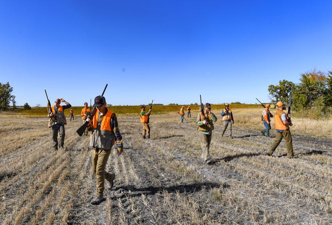 Pheasant hunters head out for the season opener on Saturday, October 19, in Mitchell.