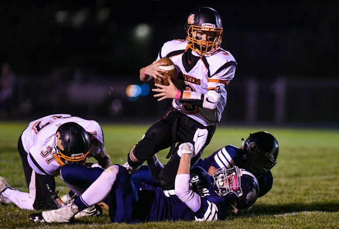 Dell Rapids quarterback Colin Rentz is sacked by a West Central player during their football game on Friday, October 18, in Hartford.