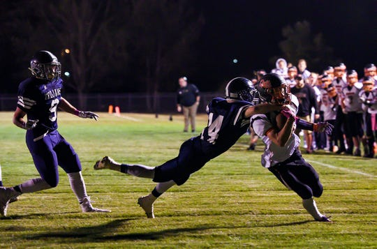 West Central defensive back Tyler Lundborg lunges for Logan Ellingson of Dell Rapids as he nears the end zone during their football game on Friday, October 18, in Hartford.