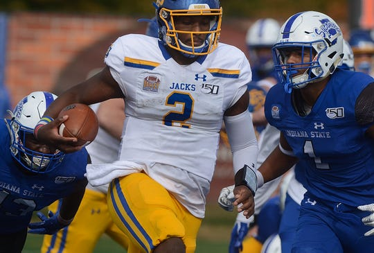 South Dakota State quarterback J'Bore Gibbs beats the Indiana State defense into the end zone to score during the Jackrabbits' 42-23 win over host Indiana State on Saturday, Oct. 19, 2019 in Terre Haute, Ind. (AP Photo/Tribune-Star, Joseph C. Garza)
