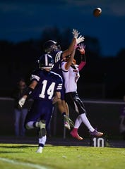 West Central player Derek Eidsness intercepts a ball intended for Logan Ellingson of Dell Rapids during their football game on Friday, October 18, in Hartford.