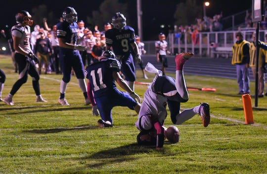 Logan Ellingson of Dell Rapids tumbles into the end zone for a touchdown during their football game on Friday, October 18, in Hartford.