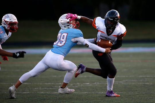 Waynesville Tiger Ronshen Butler-Lawson pushes off Glendales Zach Highlander as he carries the ball during a game at Glendale on Friday, Oct. 18, 2019.