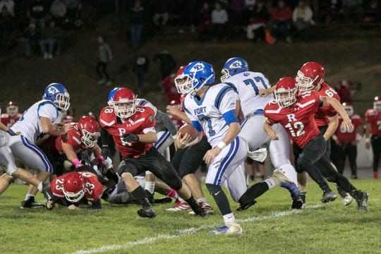Fort Defiance's Austin Monroe tries to find a way around the Riverheads defense Friday night.