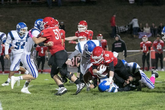 Riverheads' Braeson Fulton is brought down by the Fort Defiance defense.