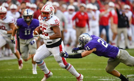 Kai Barber rushes for St. John's during the game Saturday, Oct. 19, 2019, against St. Thomas at Allianz Field in St. Paul.
