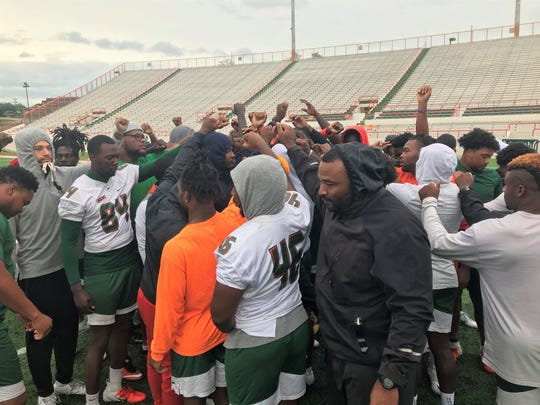 FAMU defensive players huddle up following a walk-through on Friday, Oct. 18. The Rattlers held practice for their game versus North Carolina A&T.