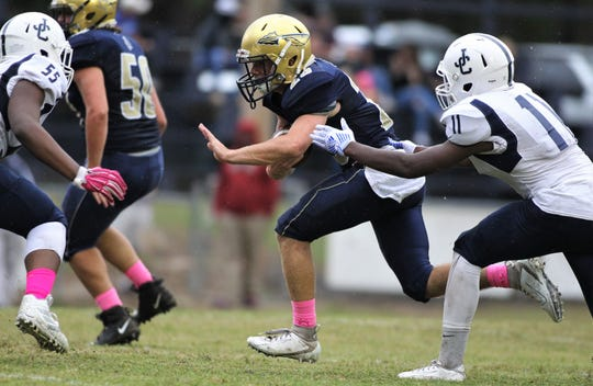 Aucilla Christian senior Brandon Hannon carries the ball for a gain as the Warriors improved to 8-0 by beating Jacksonville's Joshua Christian 41-6 on Friday, Oct. 18, 2019.