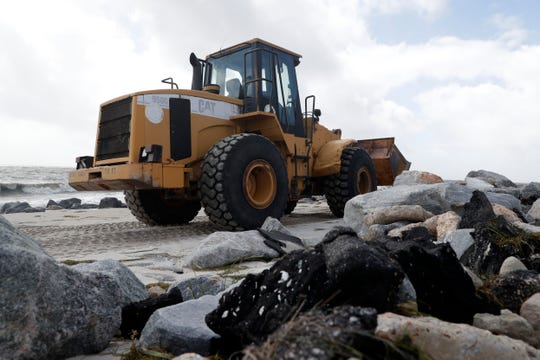 A crew began working on cleaning up the portion of Alligator Drive in Alligator Point, Florida, which was washed away by Tropical Storm Nestor on Saturday, Oct. 19, 2019.