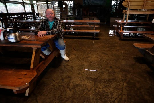 Stan West, the owner of Riverside Cafe in St. Marks, Florida, sits in his restaurant as he waits for Tropical Storm Nestor to pass Saturday, Oct. 19, 2019. He prepared for the storm by placing anything he could a foot or higher off the ground.