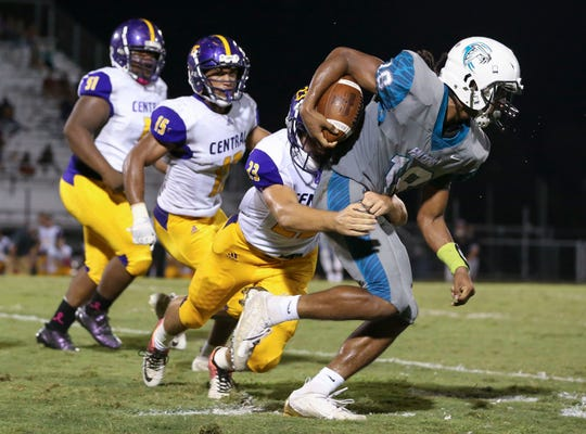 Fort Pierce Central's Robert Russakis (23) tackles Jensen Beach's DaQuan Gonzales (18) during the second quarter in a high school football game at Jensen Beach High School on Friday, Oct. 18, 2019, in Jensen Beach.