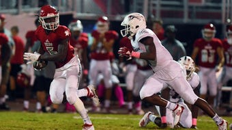 Jermaine Dawson caught two touchdown passes and the defense registered a shutout. The win was Vero Beach's 60th consecutive in the regular season.