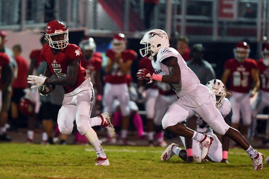 Vero Beach High School's Jermaine Dawson sprints away from defenders en route to a touchdown on Friday, Oct. 18, 2019, during a game against Chaminade-Madonna at the Citrus Bowl in Vero Beach. Dawson scored two touchdowns on the night as the Fighting Indian went on to win the game 21-0.