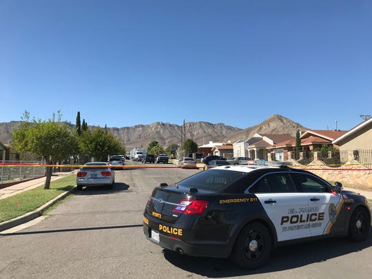 An El Paso police patrol car blocks off the 3800 block of Truman Avenue in El Paso on Saturday after a shooting left one dead and three wounded.