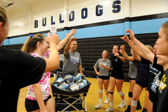 Head coach Eric Valdivia rallies his Buena High girls volleyball team during Friday's practice. After winning a share of the Pacific View League title, the Bulldogs will compete in the CIF-SS Division 4 playoffs.