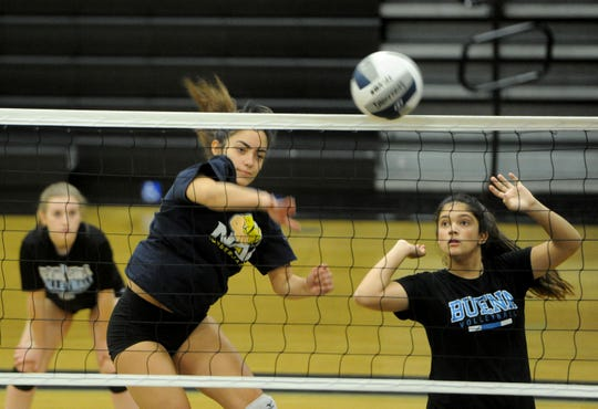 Jazmin Varela slams the ball over the net during Buena High's practice Friday. The junior setter has amassed 285 assists, 180 kills, 130 digs and 54 service aces this season for the Bulldogs.