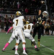 Oak Park's Luka Sarac jumps to knock down a pass from Simi Valley's Travis Throckmorton during the Eagles' 31-7 victory on Friday night in a Canyon League opener.