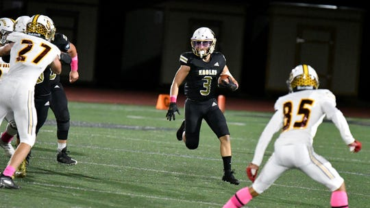 Oak Park High running back Matt Mori eyes an opening in the Simi Valley defense during the Eagles' 31-7 victory on Friday night in a Canyon League opener.