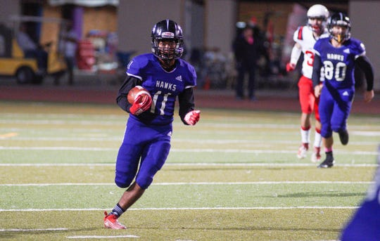 Mission Oak's Darren See rushes for positive yards during a East Yosemite League high school football game between Tulare Western and Mission Oak in Tulare Friday night.