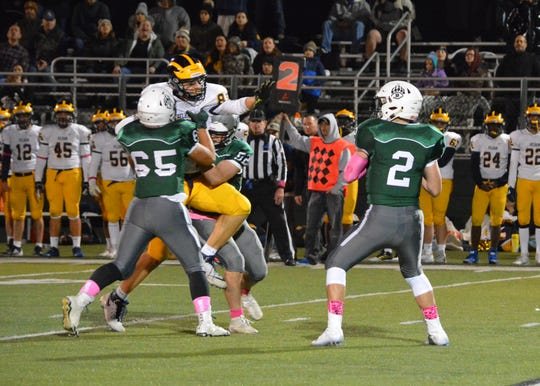 Dominic Rienzi and William Finn give Brewster quarterback Chris Donohue just enough time to go deep in the second quarter of the Bears' postseason win over Pelham on Oct. 18, 2019 at Brewster High School