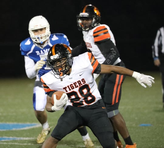White Plains' Christion Young gains some yards against Port Chester, during their game at Purchase College, Oct. 18, 2019.