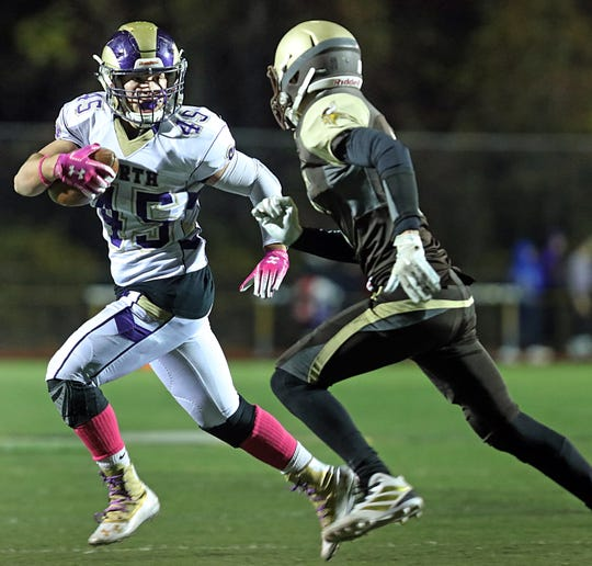Clarkstown North's Tristan Lebson (45) pushes the ball up the field past Clarkstown South defense during Section 1 Class A playoff football game in West Nyack Oct. 18, 2019. Clarkstown North defeats Clarkstown South 20-0.