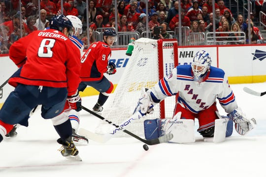 Oct 18, 2019; Washington, DC, USA; New York Rangers goaltender Henrik Lundqvist (30) makes a save on Washington Capitals left wing Alex Ovechkin (8) in the second period at Capital One Arena. Mandatory Credit: Geoff Burke-USA TODAY Sports
