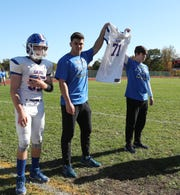 Andy Nezaj, 21 left, and Leon Nezaj, 13 right, brothers of Altin Nezaj were on the field with the team for the coin toss at the  'Little Brown Jug' game at Nanuet High School on Saturday, October 19, 2019.