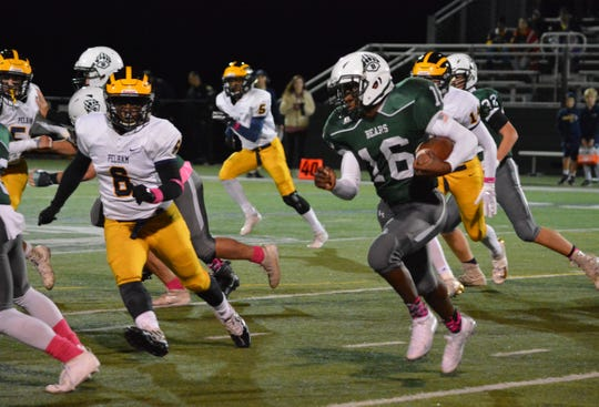 Brewster wideout Justin Niles gets around the left side for a short gain in the second quarter of a 49-14 win over Pelham in a Class A playoff qualifier on Oct. 18, 2019 at Brewster High School.