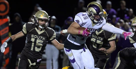 Clarkstown North's Tristan Lebson (45) tries to shake off Clarkstown South defense during Section 1 Class A playoff football game at Clarkstown South High School in West Nyack Oct. 18, 2019. Clarkstown North defeats Clarkstown South 20-0.