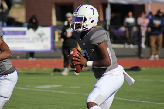 New Rochelle quarterback Tariq Benjamin with the ball during a football game against Spring Valley at New Rochelle High School on Saturday, October 19th, 2019.