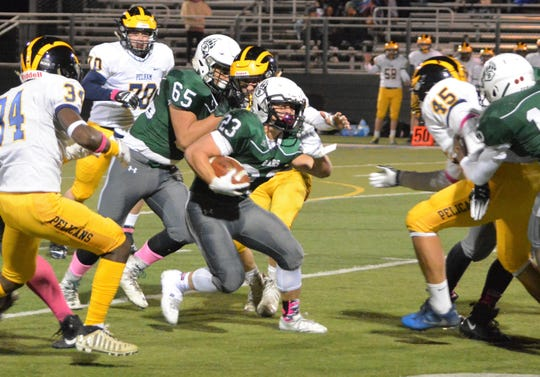 Brewster running back Thomas Consolato finds room to run in the first quarter of a 49-14 win over Pelham on Friday at Brewster High School. The Bears move on to next week's Section 1 Class A quarterfinal round.