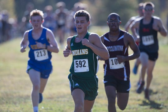 Runners churn their way to the finish at the Joe O'Neill Invitational on Oct. 19 at Bellevue State Park in Wilmington.