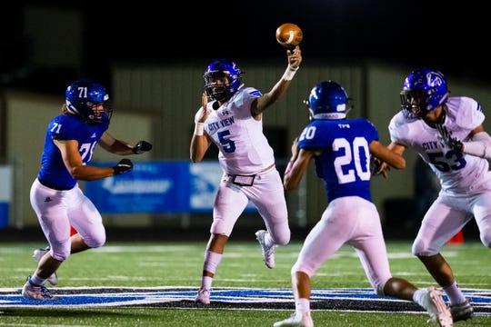 City View junior quarterback Isaiah Marks (5) passes before Gunter's Braden Sloan can reach him Friday, Oct. 18, 2019.