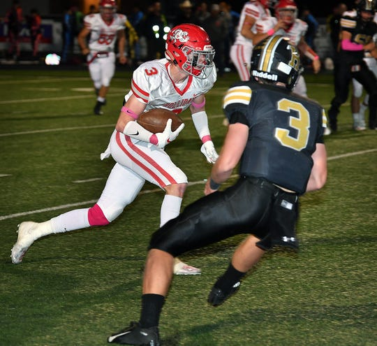 Holliday Eagles ball carrier Mark Hardin (3) cuts inside for a big gain in an October game against Henrietta.