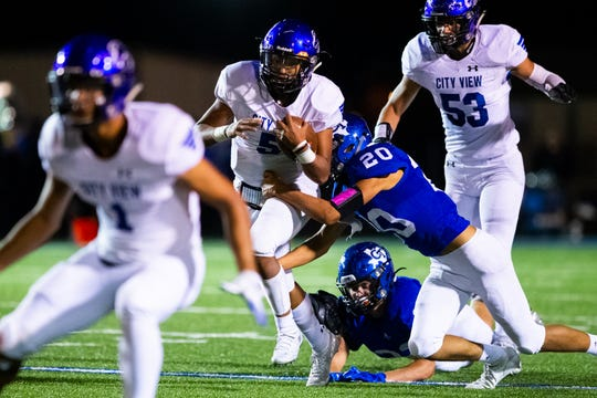 City View's Isaiah Marks runs through the tackle of Gunter's Martin Garcia on Friday, Oct. 18, 2019.