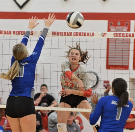 Sheridan's Ally Perkins hits a kill during the Division II sectional final against Washington Court House on Saturday. The Generals won in three sets.