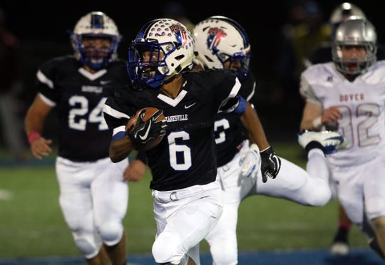 Zanesville's Jeremiah Norman returns a long, zig-zagging punt return against Dover. He was downed at the 2.