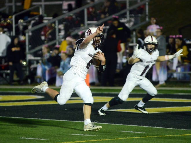 Noah Wellmeier runs into the end zone during the third quarter of John Glenn's 24-21 win against Tri-Valley on Friday night at Jack Anderson Stadium.