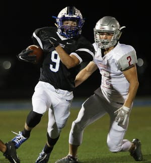 Zanesville's Jordan Martin runs with the ball during a 2019 game against Dover at John D. Sulsberger Memorial Stadium. Martin is one of three returning starters on offense for the Blue Devils.