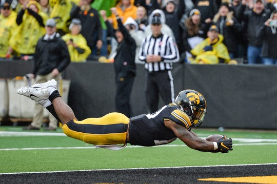 Iowa Hawkeyes running back Mekhi Sargent leaps into the end zone to score a touchdown against the Purdue Boilermakers during the fourth quarter at Kinnick Stadium.