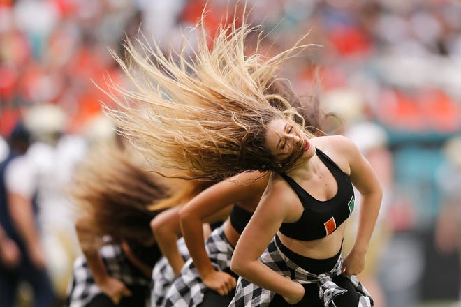 The Miami Hurricanes dance team performs against the Georgia Tech Yellow Jackets during the first half at Hard Rock Stadium in Miami, Fla.
