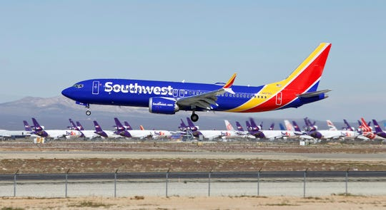 In this March 23, 2019 file photo a Southwest Airlines Boeing 737 Max aircraft lands at the Southern California Logistics Airport in the high desert town of Victorville, Calif. Southwest said Thursday, Oct. 17, that it will keep its Boeing 737 Max jets out of its schedule until Feb. 8, about a month longer than previously planned.