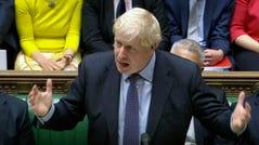 Britain's Prime Minister Boris Johnson speaks inside the House of Commons, on Oct. 31, in London.
