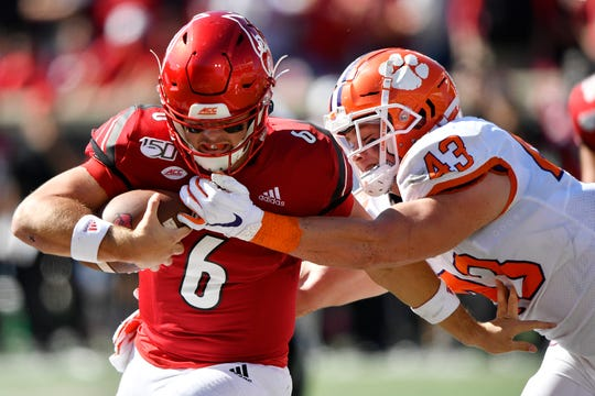 Clemson Tigers linebacker Chad Smith tackles Louisville Cardinals quarterback Evan Conley during the second quarter of play at Cardinal Stadium.